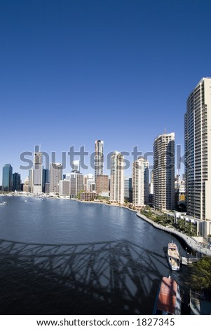 portrait of brisbane city skyline with river in front - stock photo