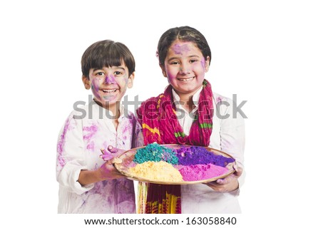 Portrait of brother and sister celebrating Holi festival