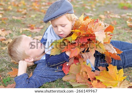 Portrait of brother and sister in autumn leaves