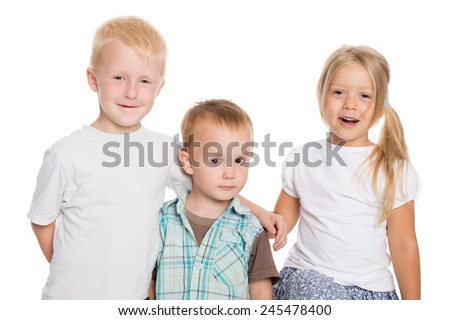 Portrait of brothers and sister isolated on white background - stock photo