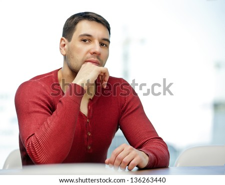portrait of brunet man looking in camera - stock photo