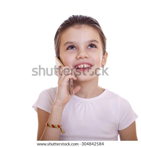 Portrait of brunette Caucasian schoolgirl calling by phone, isolated on white background - stock photo