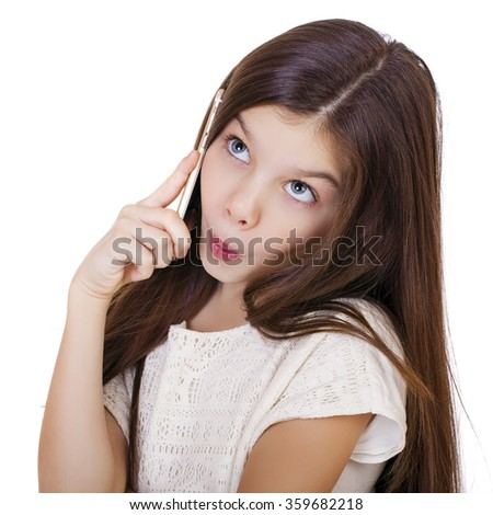 Portrait of brunette Caucasian schoolgirl calling by phone, isolated on white background