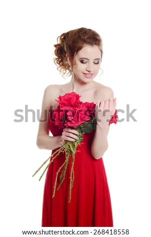 Portrait of brunette girl in red dress with bouquet of red roses