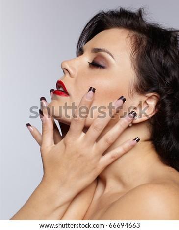 portrait of brunette girl posing on gray - stock photo
