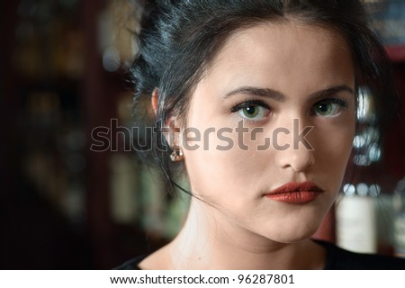 Portrait of brunette girl with green eyes - stock photo