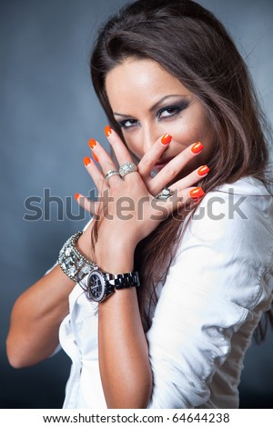 Portrait of brunette girl with red nails - stock photo