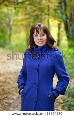 Portrait of brunette woman in autumn park - stock photo