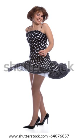 portrait of brunette woman in polka-dot dress