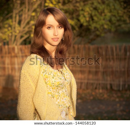 Portrait of Brunette Woman in Sunny Autumn Evening