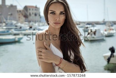 Portrait of brunette woman with long hair - stock photo