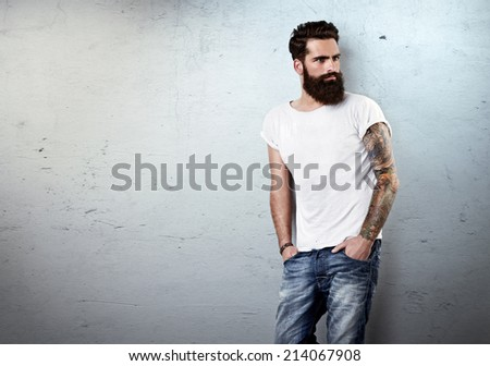 Portrait of brutal bearded man wearing blank t-shirt - stock photo