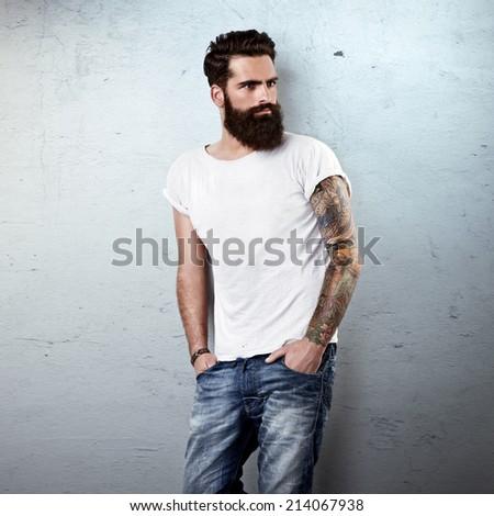 Portrait of brutal bearded man wearing white blank t-shirt - stock photo
