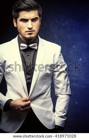 Portrait of brutal handsome man in jacket - stock photo