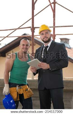 Portrait Of Builder And Businessman Working At Construction - Group Of Male Architect And Construction Worker On Construction Site - stock photo