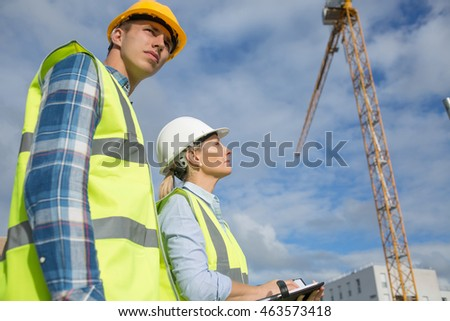 Portrait of builder works at construction site