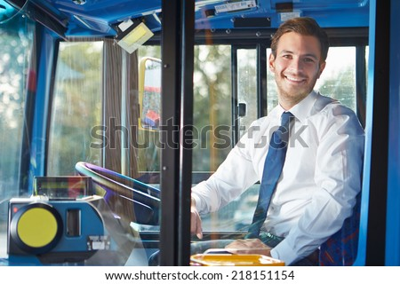 Portrait Of Bus Driver Behind Wheel
