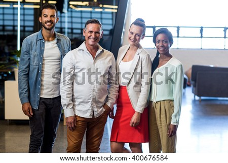 Portrait of business colleagues posing together in the office - stock photo