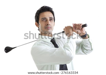 Portrait of business executive with golf club