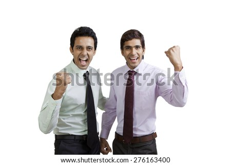 Portrait of business executives cheering - stock photo