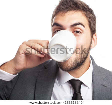 portrait of business man drinking a coffee cup on white background