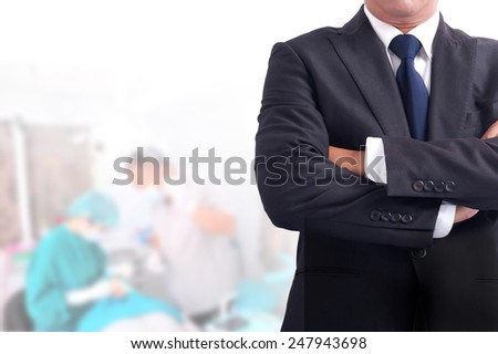 Portrait of business man has  background .cross one's arm - stock photo