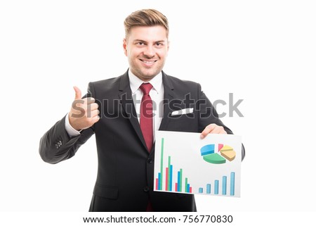 Portrait of business man holding graphs showing like or thumb up gesture isolated on white background