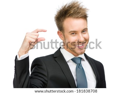 Portrait of business man showing small amount of something, isolated on white