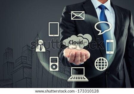 portrait of Business man with cloud computing concept on virtual background - stock photo