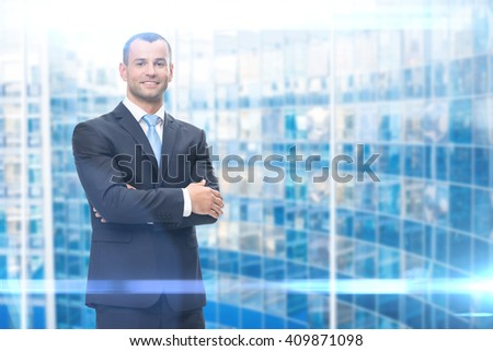 Portrait of business man with hands crossed, blue background. Concept of leadership and success - stock photo