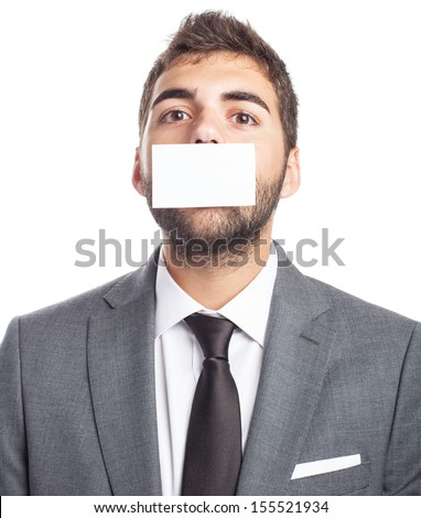 portrait of business man with mouth covered with a paper card