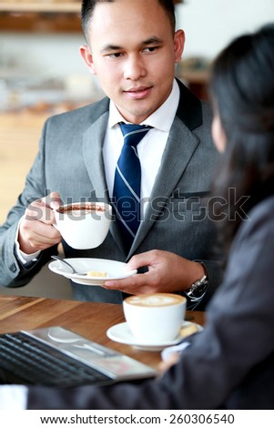 portrait of business meeting over coffee - stock photo