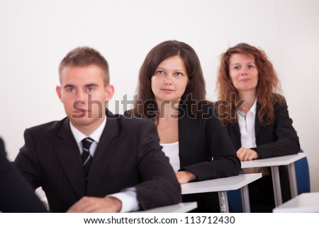 Portrait Of Business People At A Business School - stock photo
