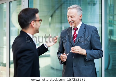 Portrait of business people discussing - stock photo