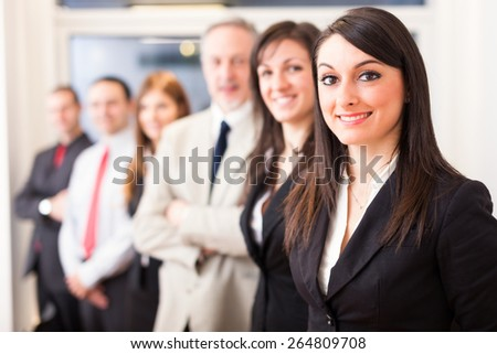 Portrait of business people in a row - stock photo