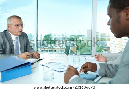 Portrait of business people interacting at meeting - stock photo