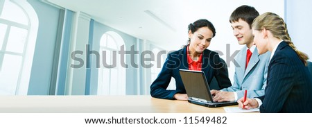 Portrait of business people interacting together on the background of office building - stock photo