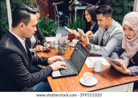 portrait of business people meeting busy working with team at a cafe