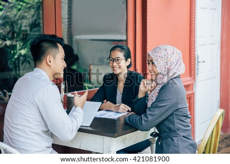 portrait of Business people meeting in a cafe - stock photo