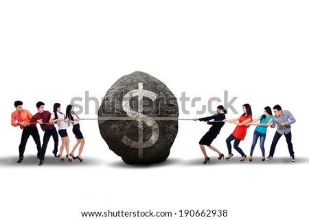 Portrait of business people pulling the big boulder on white background - stock photo
