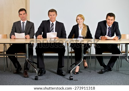 Portrait of business people sitting in office - stock photo