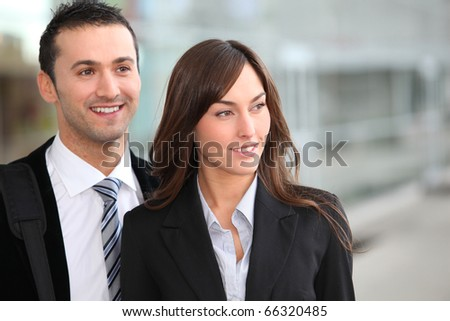 Portrait of business people standing outside the airport - stock photo