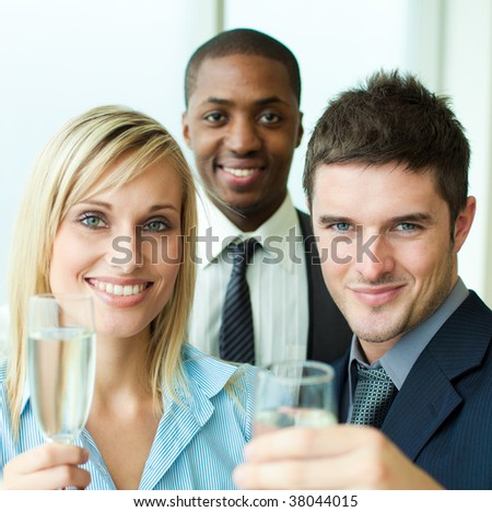 Portrait of business people toasting with champagne in an office - stock photo