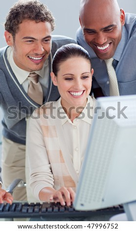 Portrait of business people working at a computer in the office