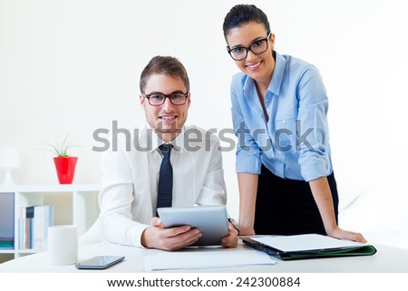 Portrait of business people working in the office with digital tablet. - stock photo