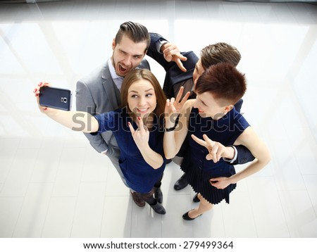 Portrait Of Business Team Capturing Selfie Together at Office - stock photo