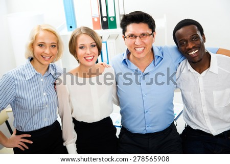 Portrait of business team in office - stock photo