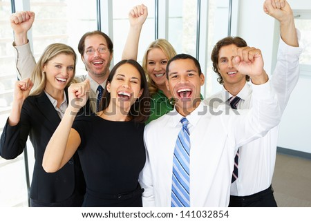 Portrait Of Business Team In Office Celebrating - stock photo