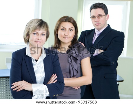 Portrait of business team in office interior