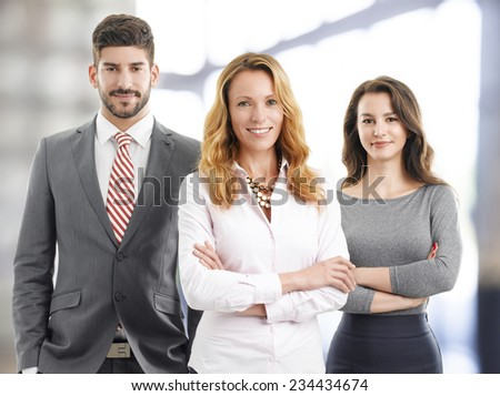 Portrait of business team standing at office.